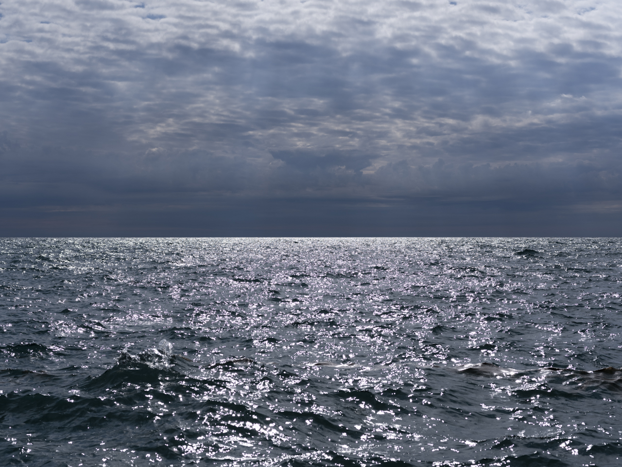 Silver skies and water on a mid-September day on Lake Michigan