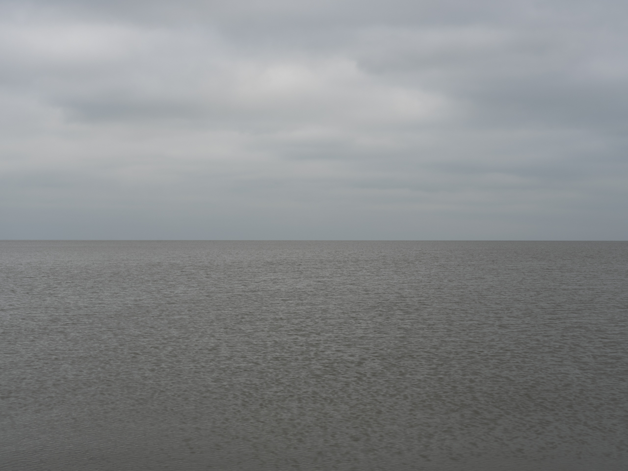 gray day with heavy clouds and rippling water