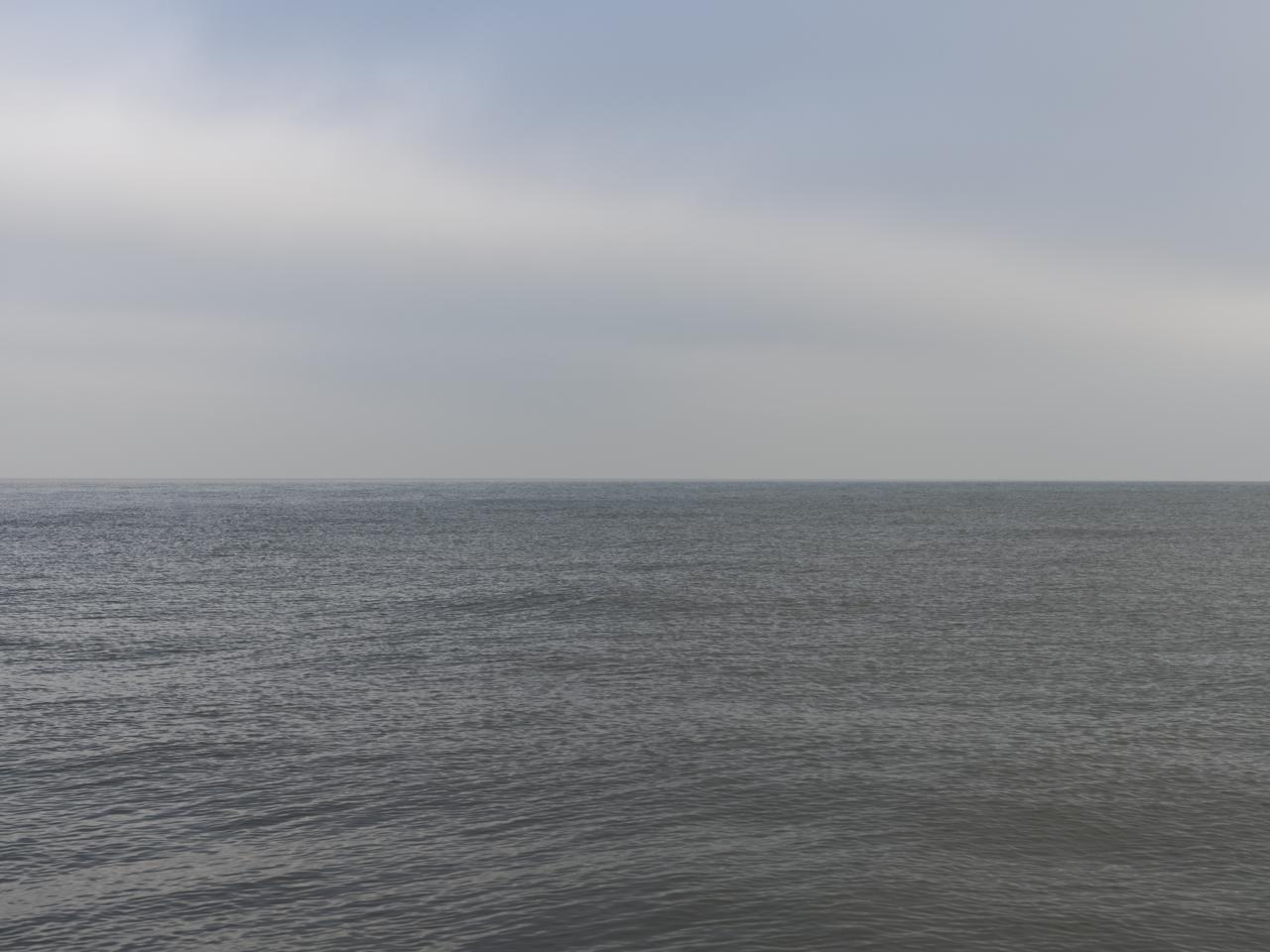 a diagonal cloud bank over Lake Michigan