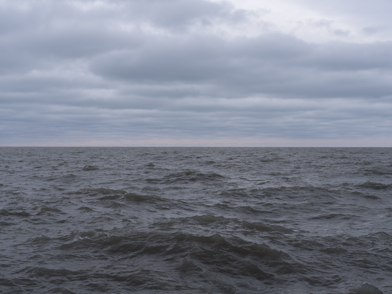 a brooding day with a pastel horizon line on Lake Michigan