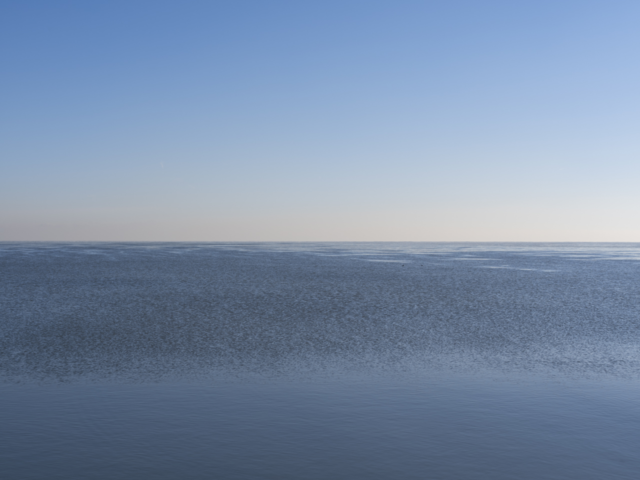 clear blue sky over rippling waters of Lake Michigan
