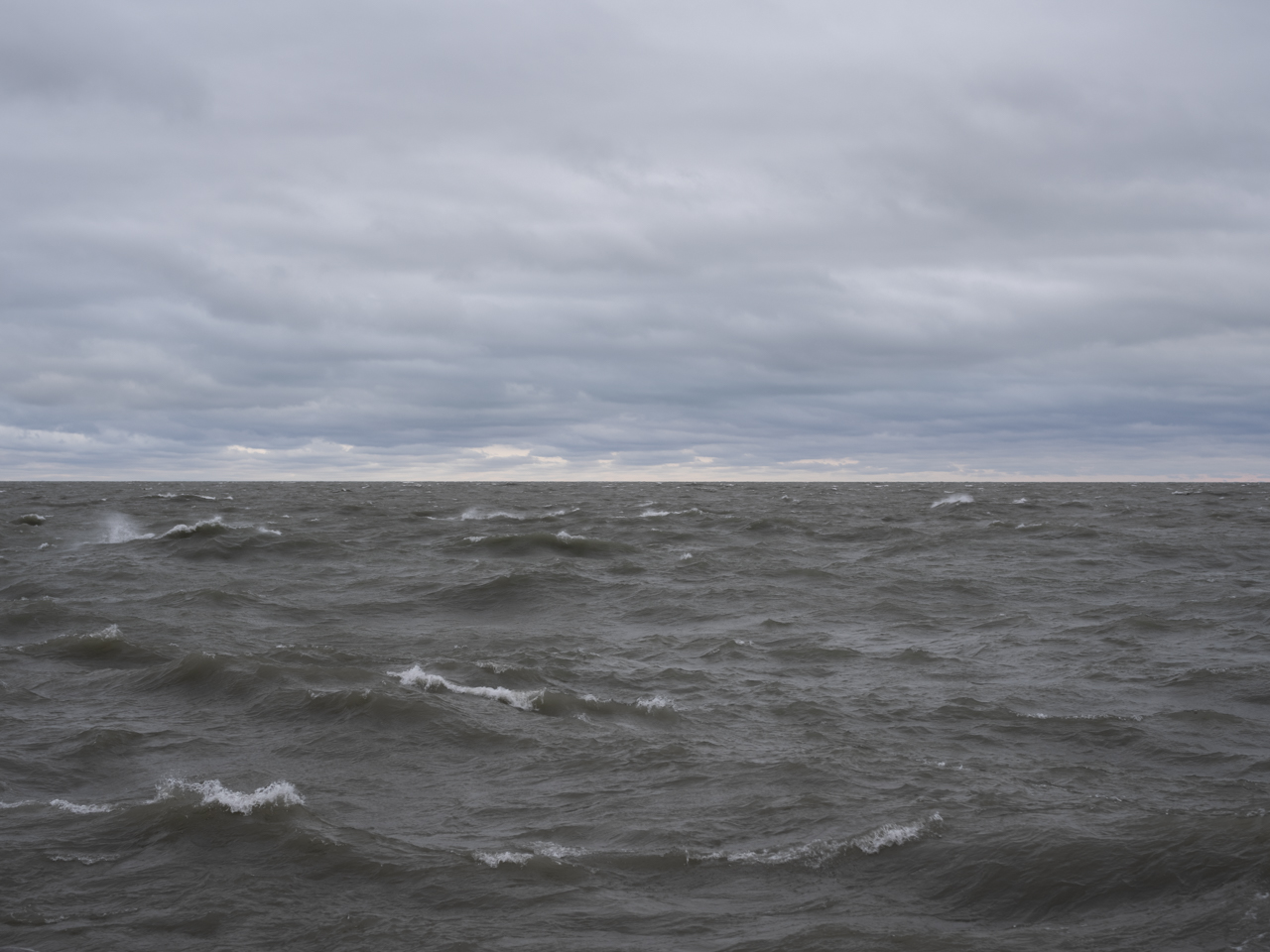 dark and cloudy skies over a tumultuous lake