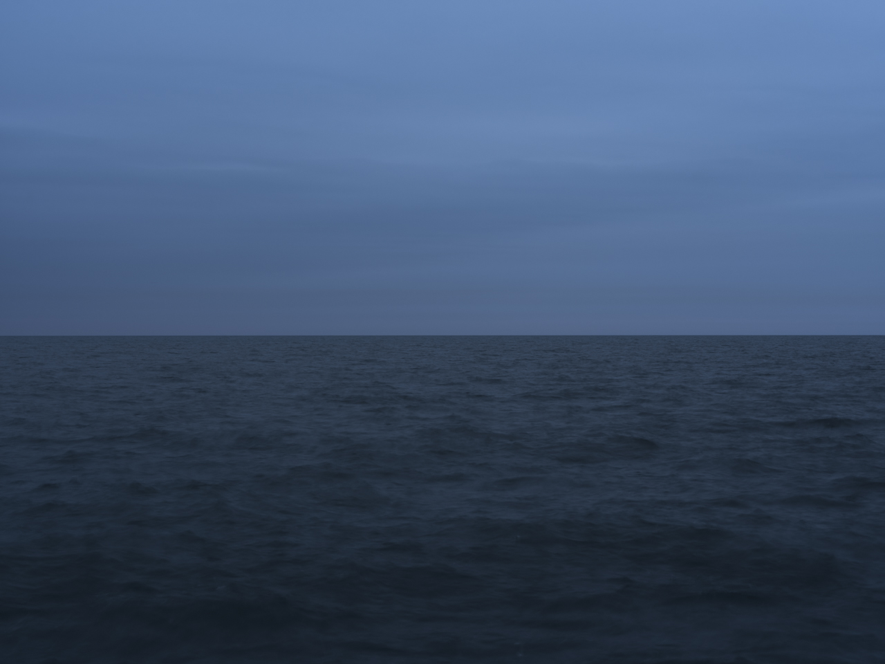 dark skies and an early morning, deeply blue and meditative