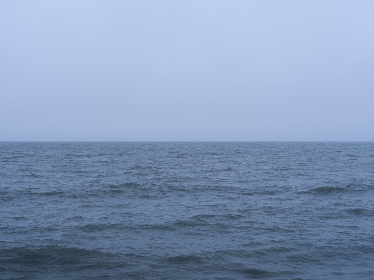 a blue day with clouds on Lake Michigan, slightly rippling waters