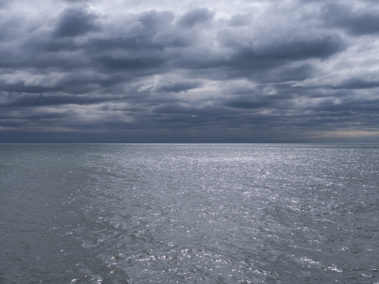 A blue and gray day with a slate blue Lake Michigan