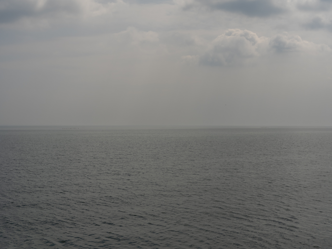 a brown and hazy day on lake michigan