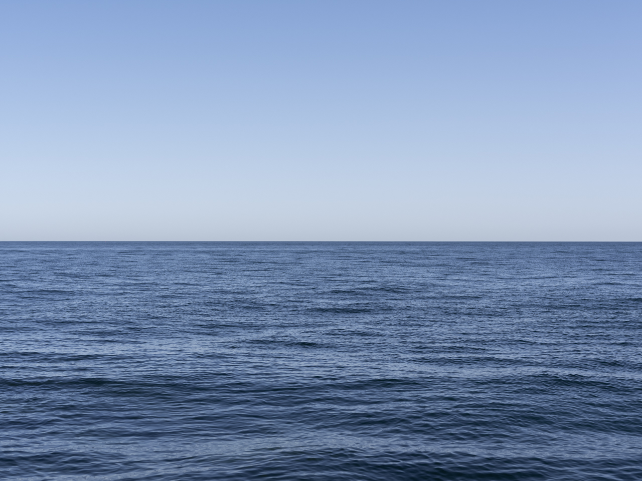 clear blue sky over a rippling Lake Michigan