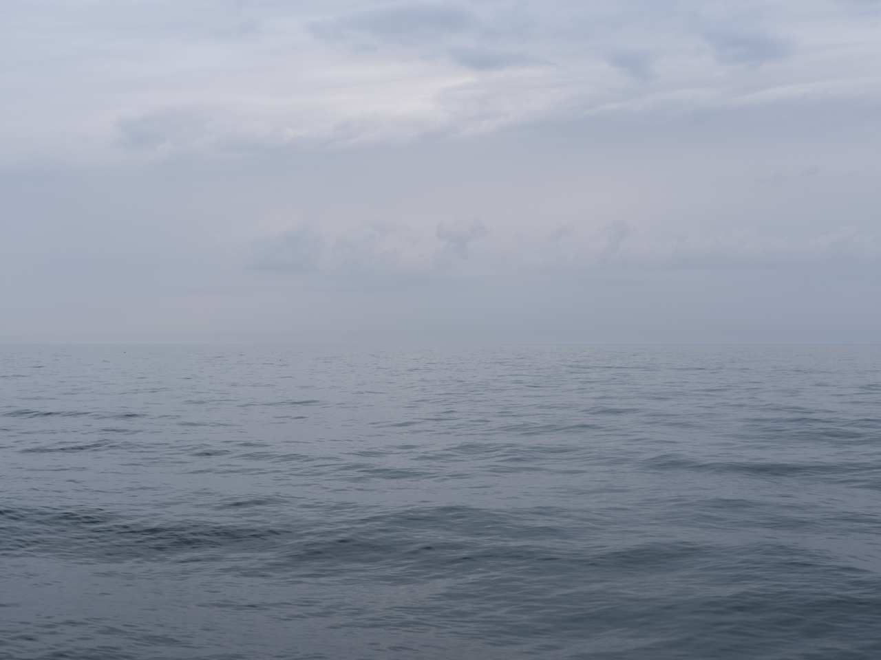 A soft sky over Lake Michigan with slight rolling waves