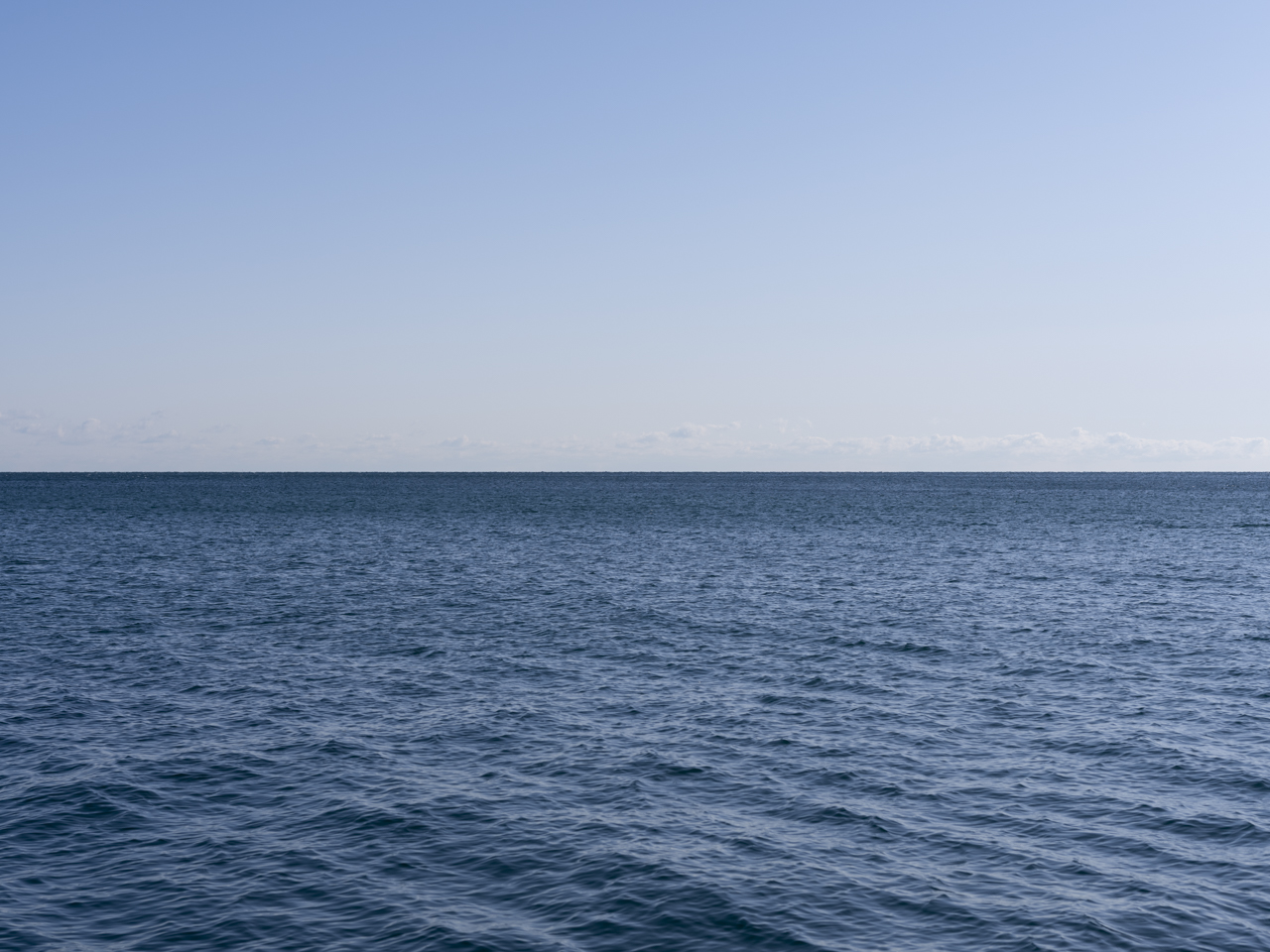 Lake Michigan with a clear sky and rippling water