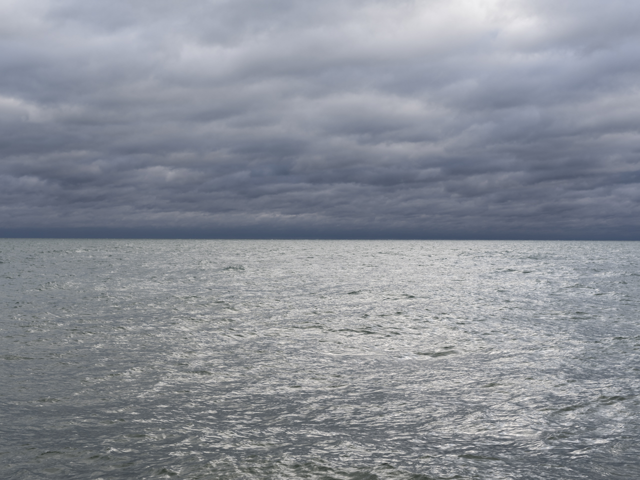 Lake Michigan on a heavily cloudy day with silvery light