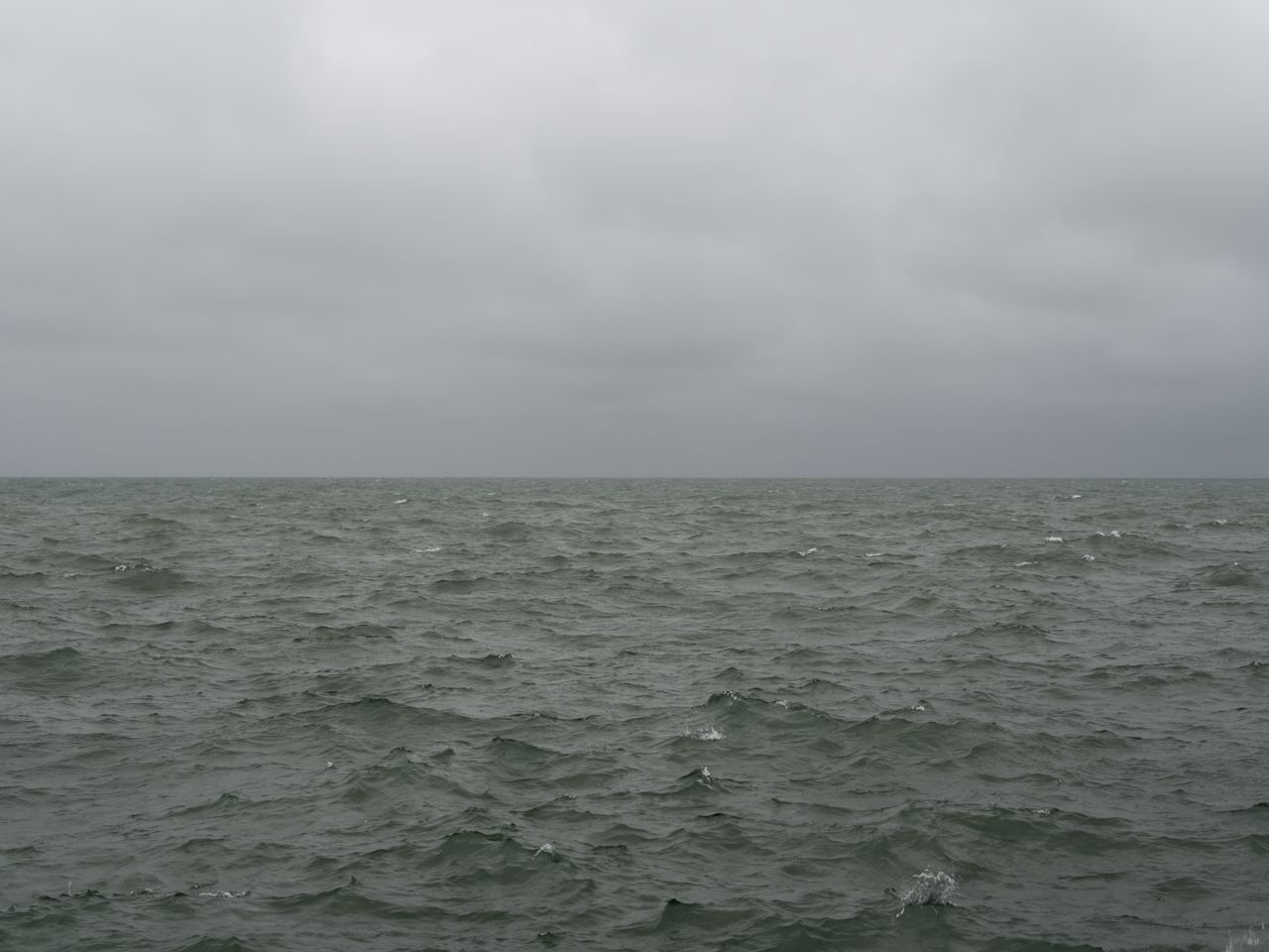 green water and a gray cloudy sky over Lake Michigan
