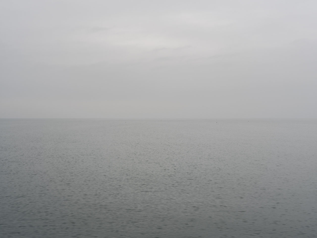 a heavy fog on a very gray day over Lake Michigan