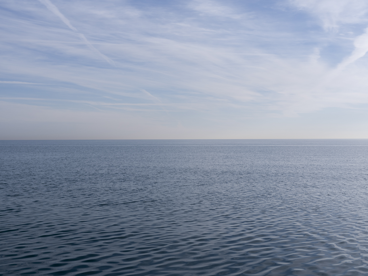 light blue morning on Lake Michigan with wispy clouds