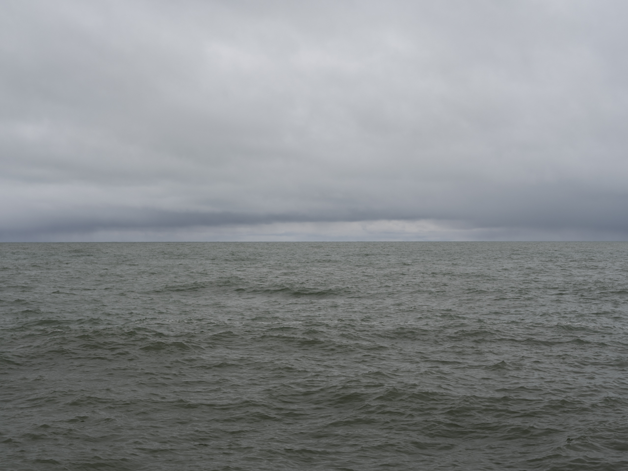gray green lake and heavier clouds on Lake Michigan