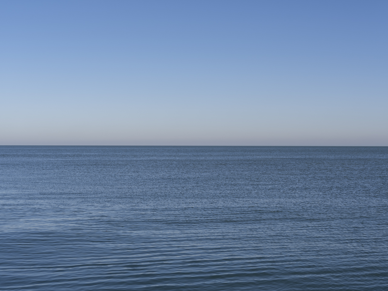 not a cloud in this brilliant blue sky over Lake Michigan on a windless day from the Lake Series, December 2019