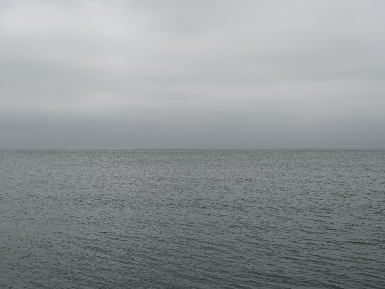 a gray day on the Lake, with heavy cloud cover and green lake waters
