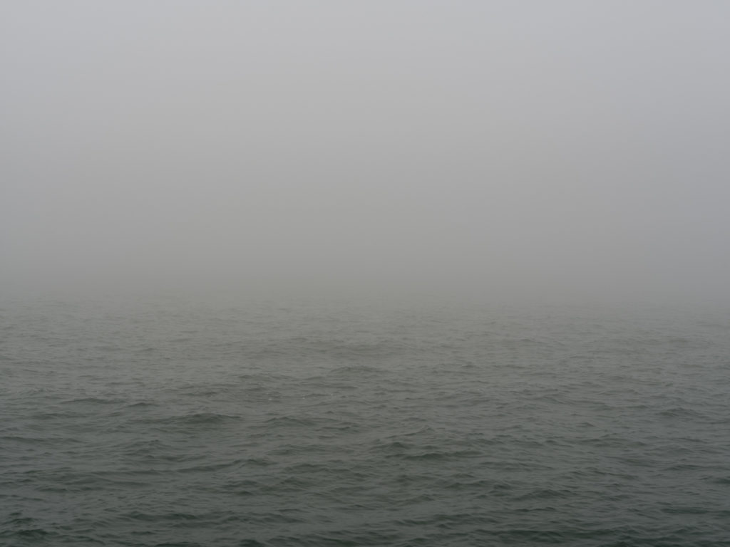 dense fog and choppy water on Lake Michigan