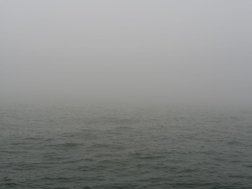 dense fog and choppy water on Lake Michigan