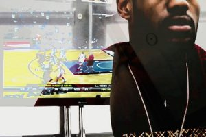 LeBron James playing video games in Lincoln Schatz's the cube in Hearst Tower