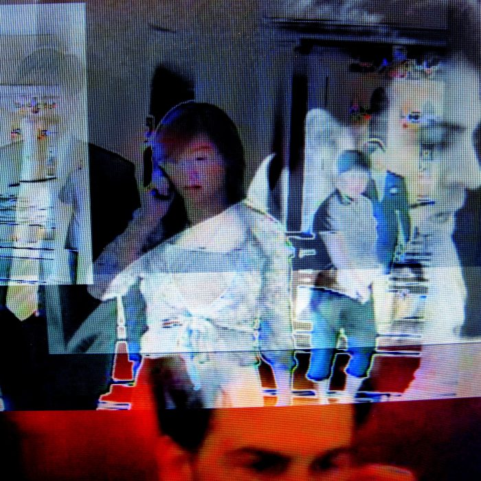 many layers of video are shown on top of one another with transparency between the layers to show a man, a woman on the phone and other semi-legible figures