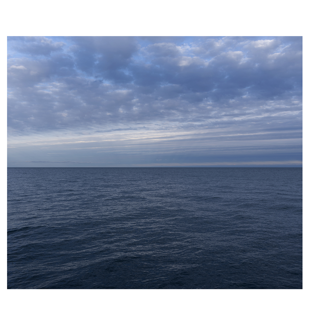 A diptych with clouds that radiate from the horizon like spokes on a bike wheel, rippling across the sky over Lake Michigan, this is the right panel.