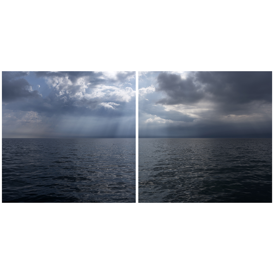Sun breaks through heavy cloud cover on this dramatically lit day on Lake Michigan.