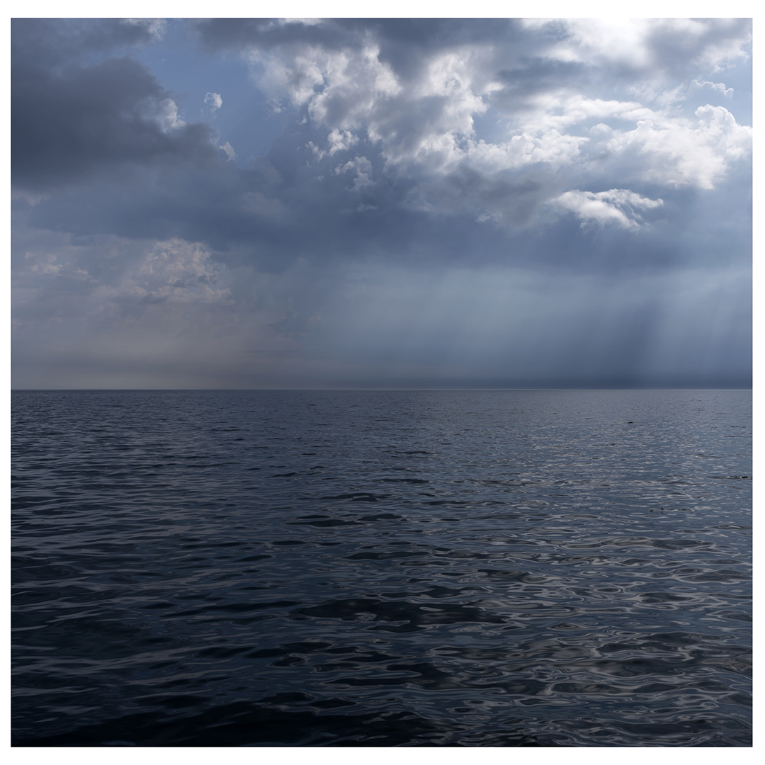 Sun breaks through heavy cloud cover on this dramatically lit day on Lake Michigan. This is the left half of the diptych.