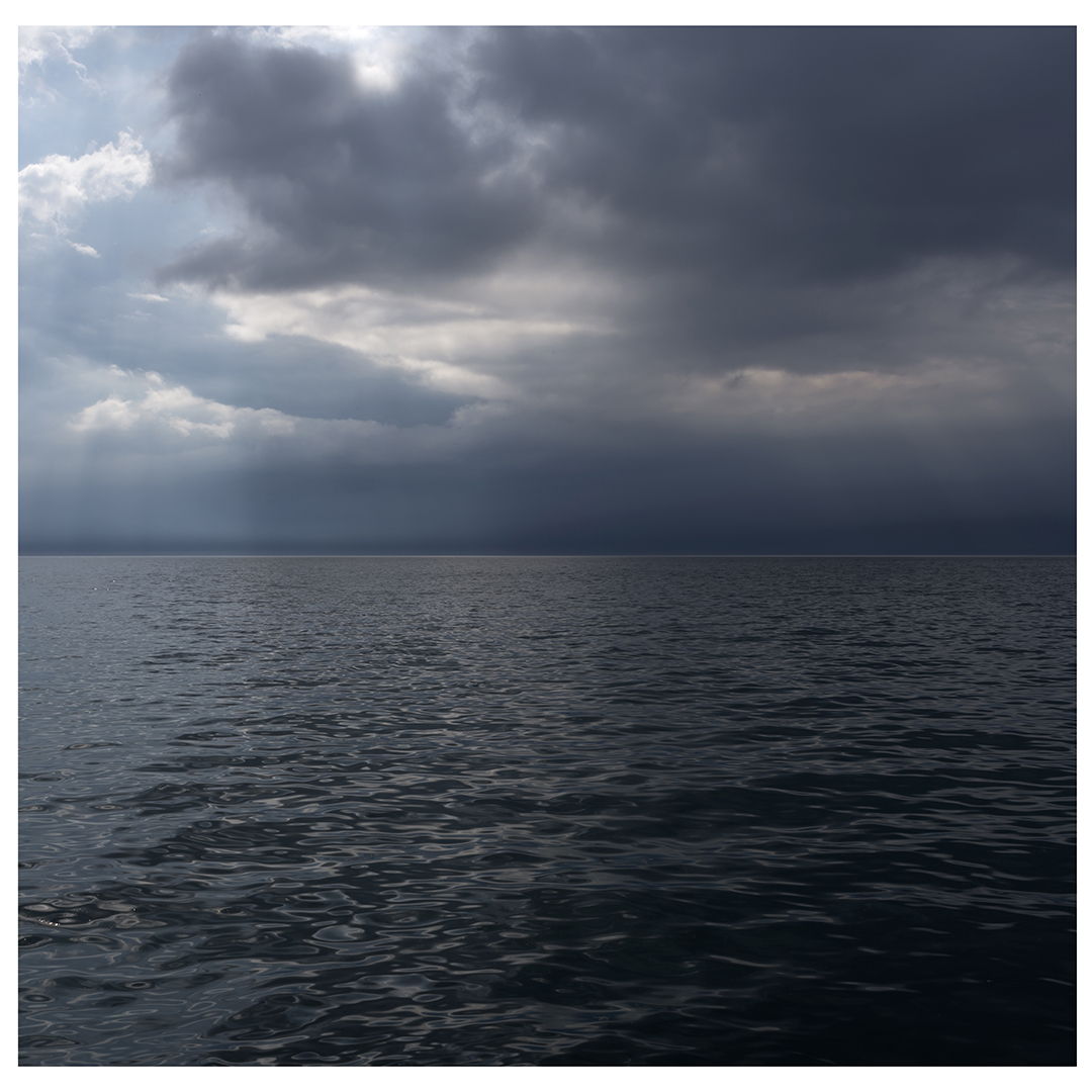 Sun breaks through heavy cloud cover on this dramatically lit day on Lake Michigan. This is the right half of the diptych.