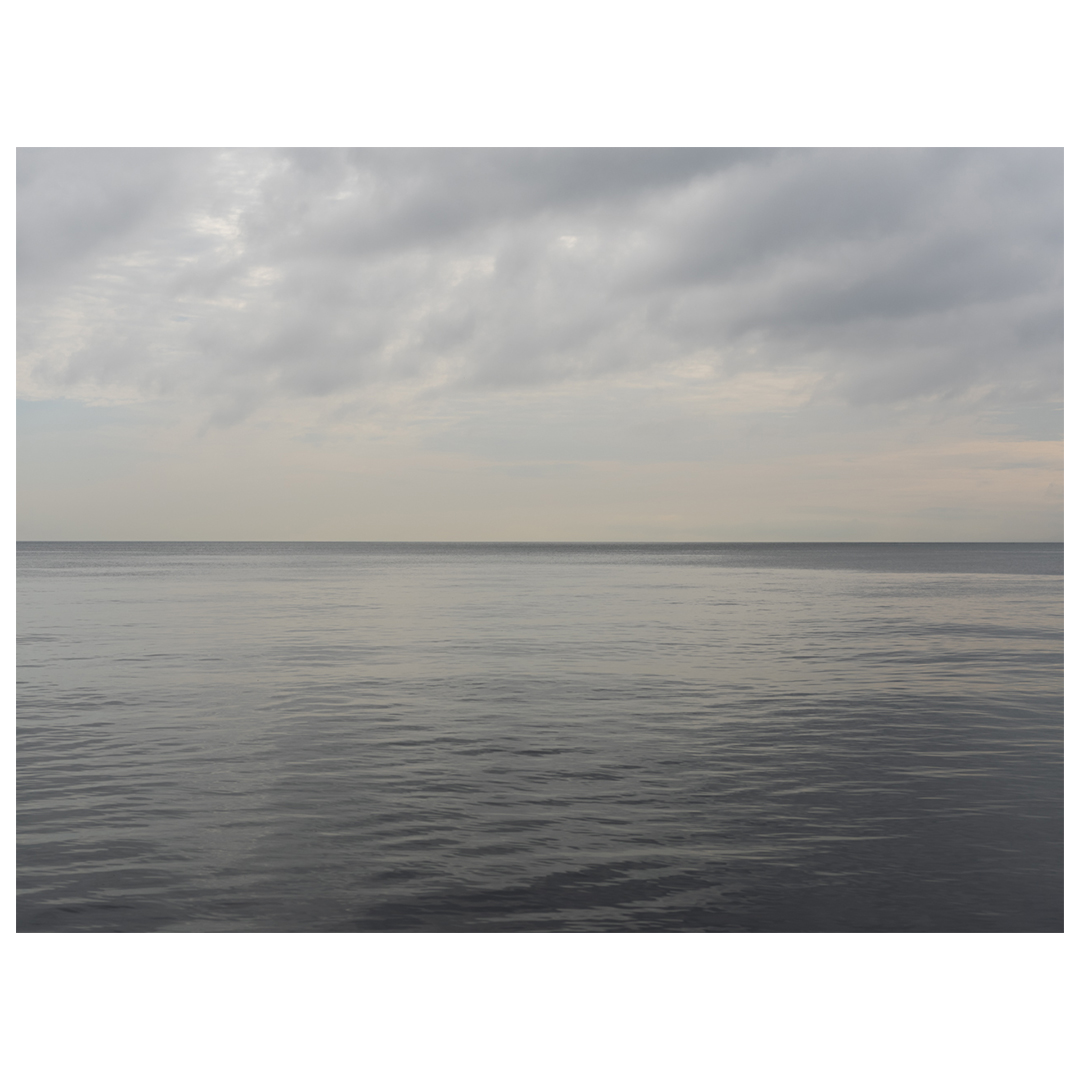 A hazy and steely gray sky greeted me on the shores of Lake Michigan.