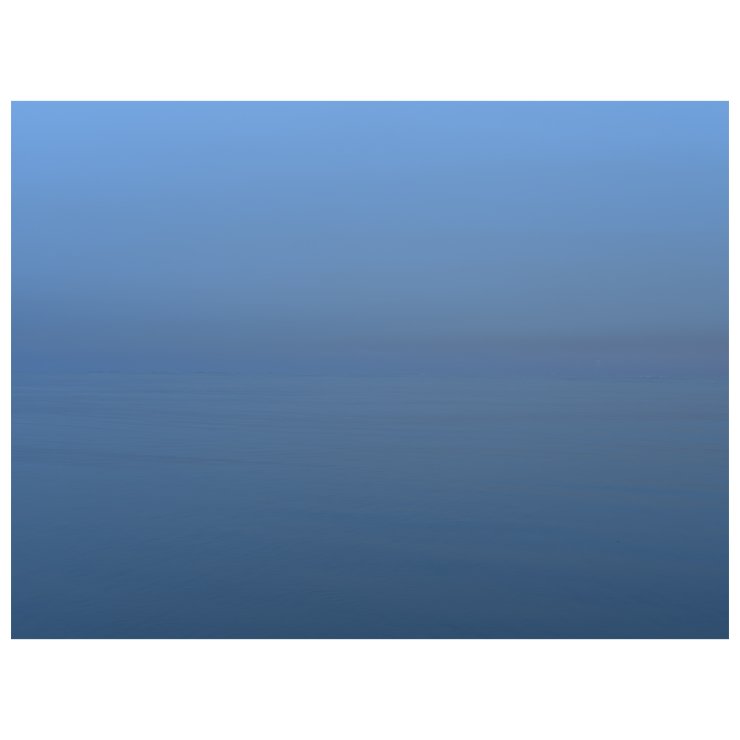 foggy blue day on lake michigan, impossible to see horizon or to even tell which is sky or water in this soft blue light