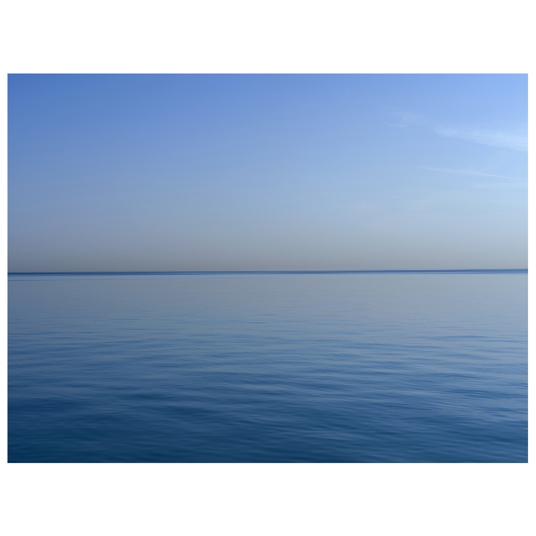 the most blue of summer days on the lake, a wisp of clouds on the right side of an otherwise still and serene day, panel 2 of 2