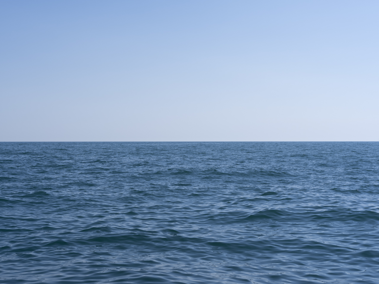 a clear blue piercingly beautiful day on Lake Michigan's shore