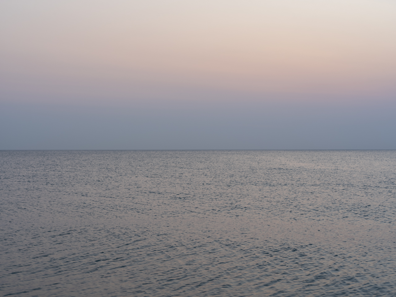 light pastel tones, blues and peaches and greens early in the morning on Lake Michigan