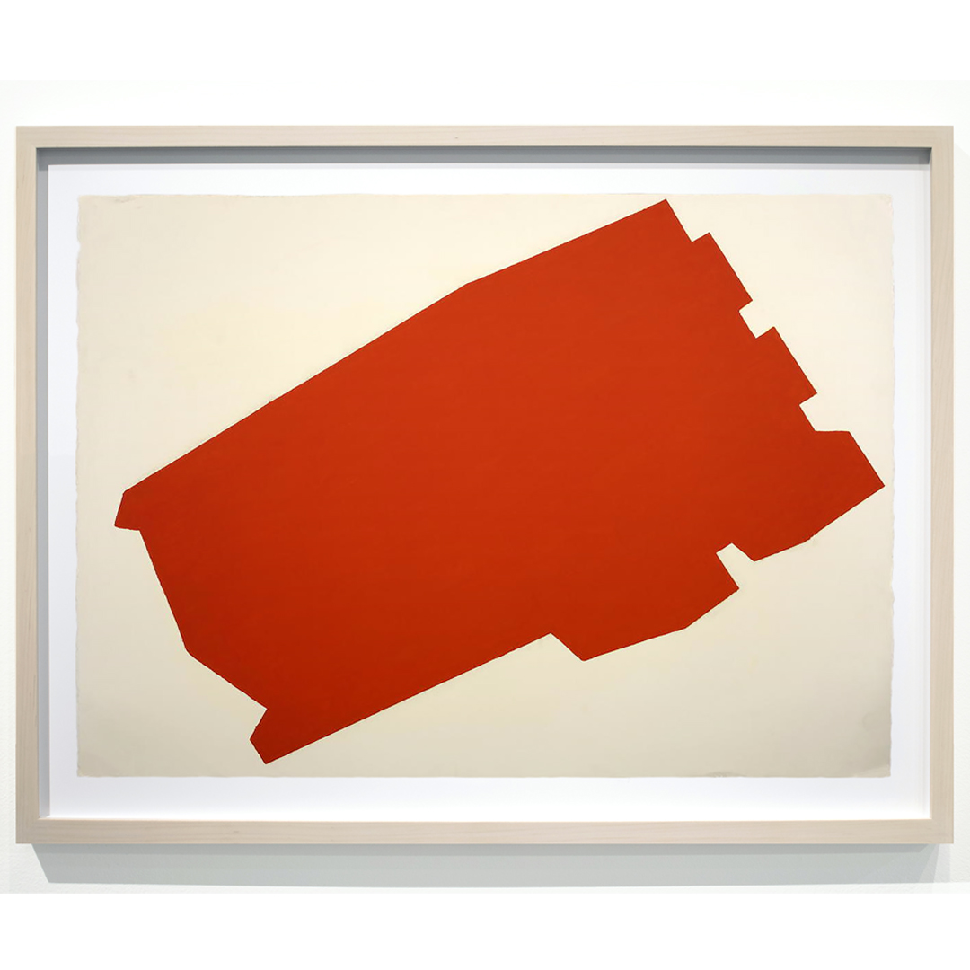 an abstract oil stick drawing on paper, in red, framed in a light maple frame