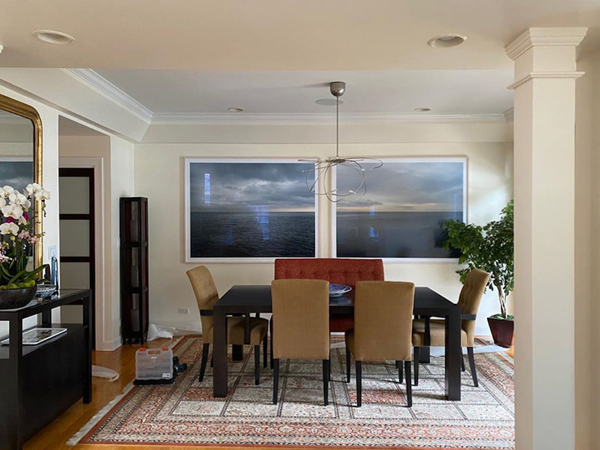 two framed lake michigan artworks by Lincoln Schatz are hung in a client's dining room