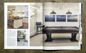 a magazine, Modern Luxury Interiors, opened to a spread that features 3 photos of Gemma Parker Design interiors, one shows the Lake Series by Lincoln Schatz