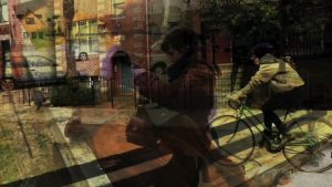 A Video Portrait of Selden features layers of images of the subject outside, riding a bike, walking on the street and reading
