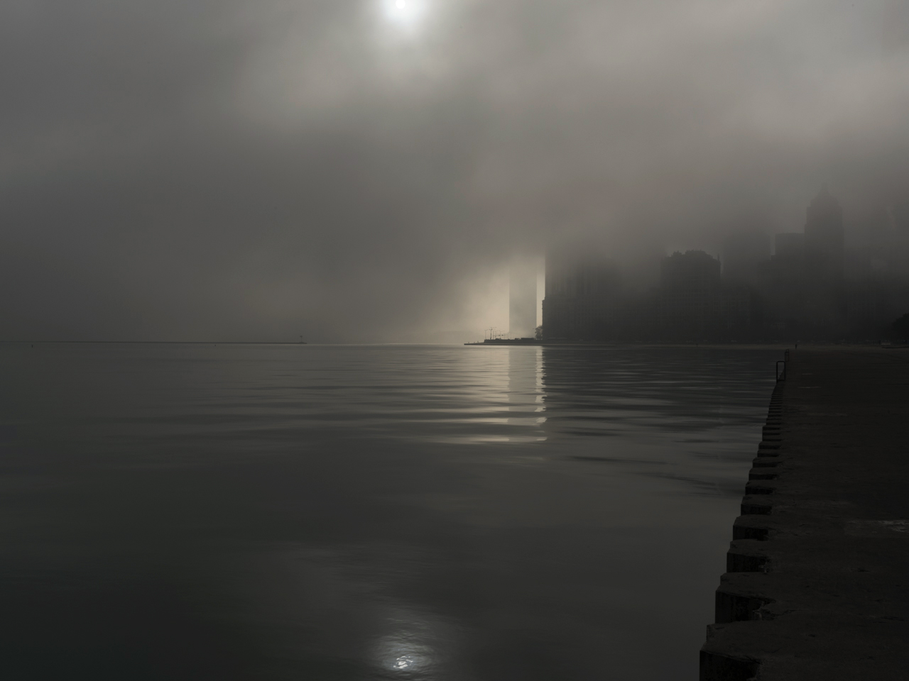 The Shore XVI, shows Chicago, covered heavily in fog, along the Lake Michigan edge of the Gold Coast region