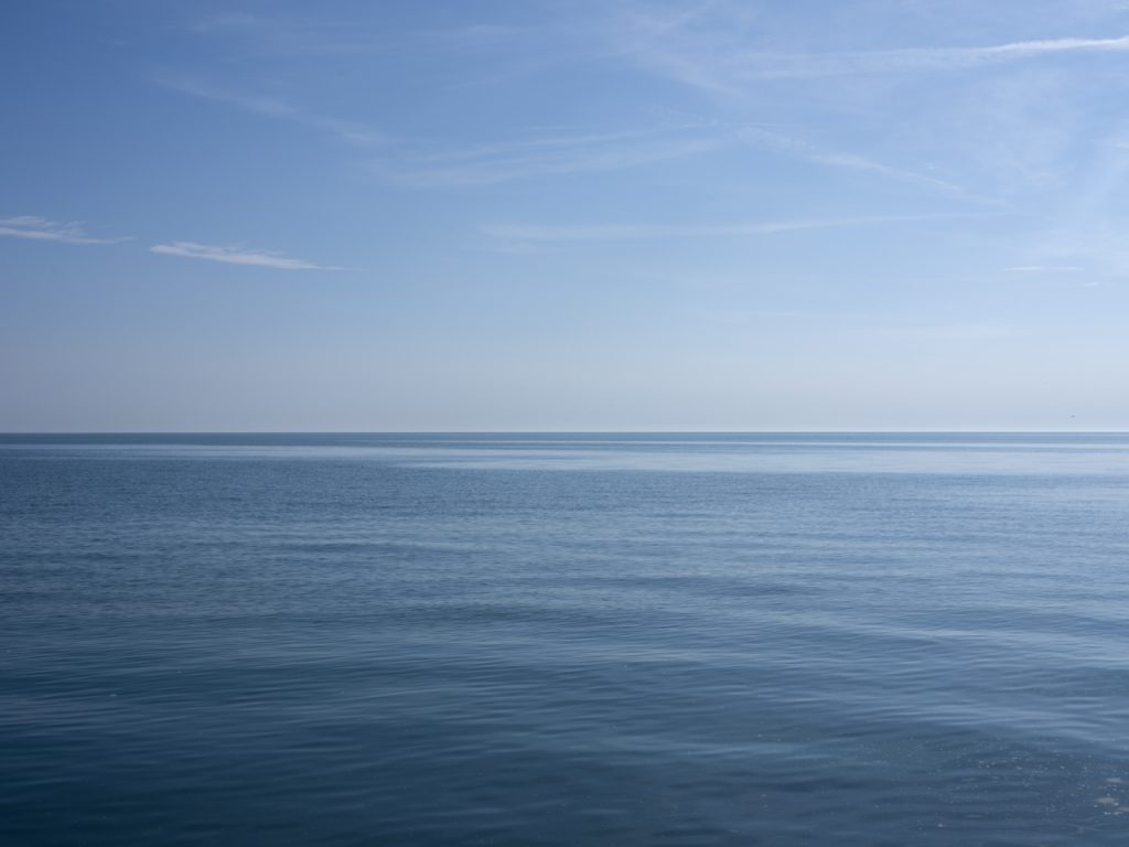 piercing blue skies over a gently ripply blue lake